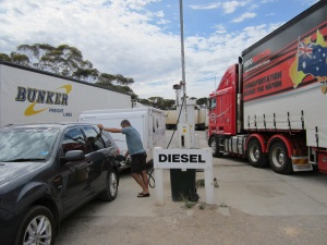 Getting fuel at Madura Pass.  The road trains are quite intimidating and there were a lot!